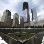 A general view shows the south pool waterfall and the under construction One World Trade Center tower in New York